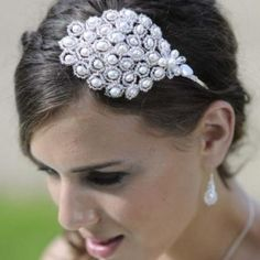 Peacock Glamour Headdress. Luxurious pearls, Swarovski crystals and silver lined beads intricately woven into a stunning feather shape. Hermione Harbutt. http://www.hermioneharbutt.com #vintage wedding.