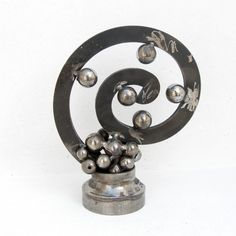 Spire metal art sculpture home decor Evolution Geometric Sculpture, Metal Art Sculpture, Modern Sculpture, Abstract Sculpture, Abstract Art, Handmade Wedding Gifts, Custom Wedding Gifts, Recycled Metal Art, Melting Metal