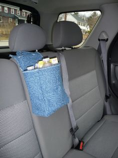 """$15.00  Need a place for trash or a place to keep the kids small toys, books, and """"busy"""" things for the car?  Kaaachews makes a caddy for you! Sturdy cotton denim."""
