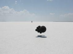 Michal Smandek, Unnatural 2, 2012, installation (black balloons, string)