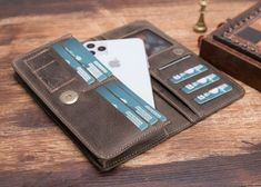 Welcome to the shop. Handmade leather wallet compatible with all models (iPhone plus,iPhone x,iPhone xs, iPhone xr,iPhone xs promax) (COMPATIBLE WITH ALL SAMSUNG MODELS) The product is Genuine Leather. The color of the product is brown. Iphone Leather Case, Iphone Wallet Case, Iphone 7 Plus Cases, Card Wallet, Handmade Wallets, Handmade Leather Wallet, Etsy, Card Holder, Samsung