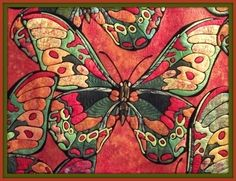 An applique butterfly might be good for the guild color challenge fabrics.