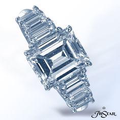 JB STAR Platinum diamond ring featuring a 3.36 ct emerald diamond with six graduated emerald cut  diamonds on the shank