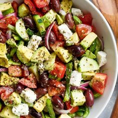 Avocado Greek Salad with a Greek Salad Dressing is a family favourite side salad served with anything! | http://cafedelites.com