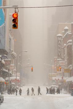 West 48th Street, Manhattan, NY  -- I'm not sure when this photo was taken, but years ago when I was in college in New York City, there was a massive snowstorm that shut down street level transportation.  It was wonderful!