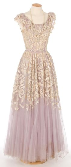 I love how dresses used to be so detailed. This dress is not only stunning, but it is also a piece of art.
