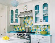 Teal, sage, and lemon kitchen. Love it! The white makes the colors crisp and clean.
