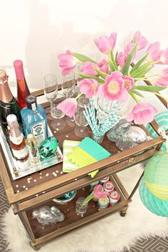 This happy and bright DIY Easter bar cart idea by  Bungalow M uses all our spring staples like pastels, flowers, and sweet candies. Learn how to style your bar cart on Best Friends For Frosting.