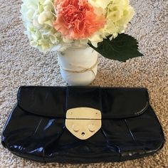 Express Clutch Shiny faux leather black foldover Express clutch with silver buckle and one zippered pocket inside.  Used once, great condition! Express Bags Clutches & Wristlets