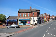 Looking up Burley Road towards Kirkstall Hill away from Leeds City Centre.