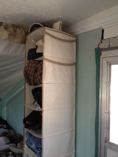 Nice idea: Attach Command Strips to ceiling to hang fabric storage units...no holes to drill. Might be weight limits...