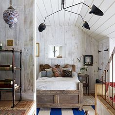 Tiny Barn Bedroom deigned by Christopher Howe where White Wood Panelling complements a variety of interesting antiques. Small Bedroom Ideas.