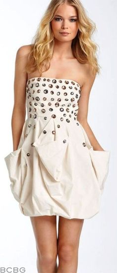 BCBG MAX AZRIA Bejeweled Taffeta Cocktail Dress in Corozo, Retailed for $348: This dress has the perfect frock for holiday events! Strapless fitted bodice with large jeweled rhinestones scattered over the front of bodice, bubble skirt with gathered side pocket details, center back exposed zipper. 35in overall length.