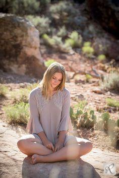 Senior Picture Ideas for Girls // desert photos of girl sitting on rocks