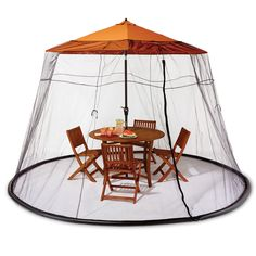 The Patio Table Mosquito Canopy - Hammacher Schlemmer