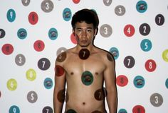 """Series by Khun Vannak on his own identity in reference to beliefs and reality in his homeland Cambodia. """"We are also numbers"""""""