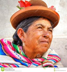 Portrait of an old woman from Cusco, Peru region. Quechua native, traditional colourful costume. Event: local traditional religious festival, Sicuani, Peru, February 2014  costume,cusco,native,old,peru,quechua,traditional,woman,adult,america,andean,andes,arequipa,beautiful,beauty,bolivia,bolivian,brown,brunette,clothes