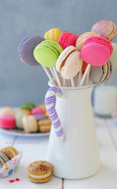 pretty rainbow coloured lolly pop macarons