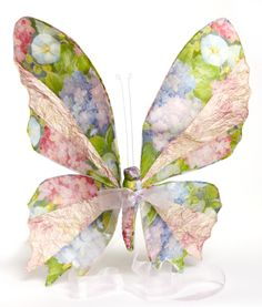 Hung on a wall or above a bed or cot, this large paper butterfly has a billowing ribbon that makes a magical feature in any child's room.