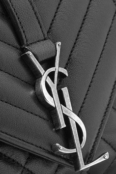 Black leather  Snap-fastening front flap Comes with dust bag Weighs approximately 2lbs/ 0.9kg Made in Italy