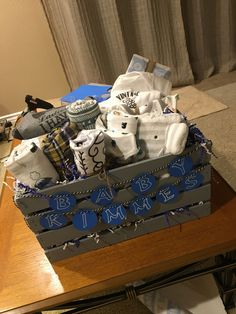 Baby shower gift basket I made! It's great because the crate can be used for babies toys, books, blankets, diapers, anything!