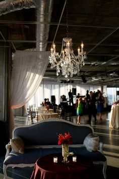 Dress up an industrial space with elegant furniture rentals, drapery and chandeliers.