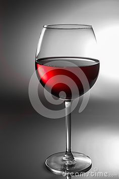 Close up of a Glas of red wine on black and white background.