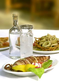 Fantastic Summer Habbit: Cloudy White Greek ouzo + along with Mezedes (wonderful little bite size appetizer foods that go well with ouzo!!)
