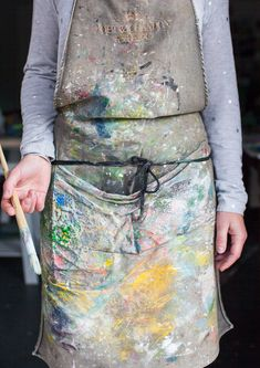 This only happens when you are wiping you brush on yourself and not on a terry cloth rag. Have a rag under your water as well as one in your hand. This apron will be stiff and not fun to wear after awhile, and clutters the mind.