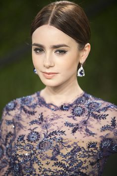 Lily Collins did a middle-parted updo at the Vanity Fair Oscars party.