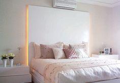 luz indireta colocada atrás da cabeceira da cama