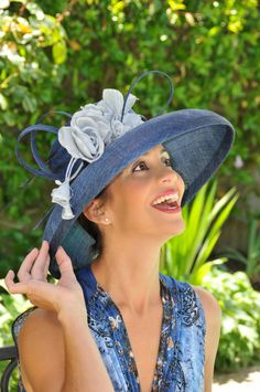 Blue straw summer hat with silk flowers by Elmira Exclusive Hats .