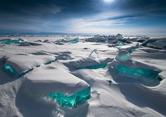Russian photographer Alexey Trofimov took a series of breathtaking photos of shimmering turquoise ice found on Lake Baikal in Russia. Known for its crystal clear water, Lake Baikal is typically fro...
