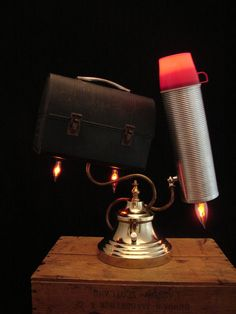 Upcycled Vintage Thermos and Lunch Box Lamp. Love how they look like they're taking off!
