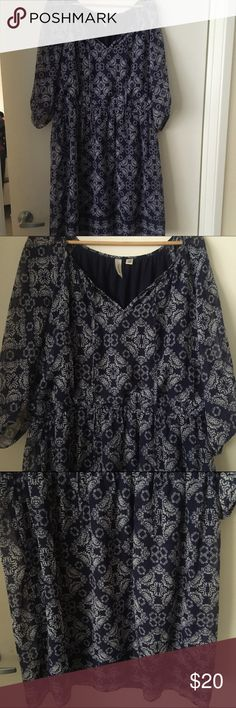 Blue printed dress A blue and white printed dress. It's thin and flowy. The sleeves are 3/4th length and have a cut down the middle for an open shoulder sleeve. It has to ties at the chest to open or close the neckline. tacera Dresses