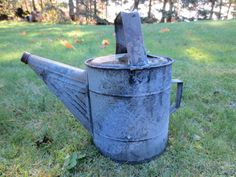 # Primitive, water can, tin, garden $25.00