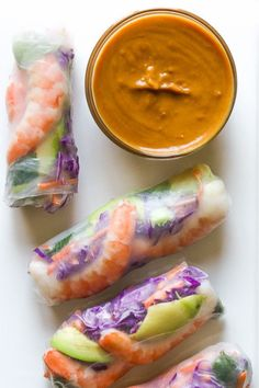 Love the colors in these FRESH homemade Vietnamese style spring rolls! They are simple to make at home and can be filled with any type of protein and veggies you like. Typically they are also filled with glass noodles, but I left them out (not a fan) and used more veggies instead. The peanut dipping sauce is the real star of the show – to-die-for! To save time, I bought beautiful cooked shrimp from costco and pre-shredded carrots. The only tricky part is wrapping the rice paper, but aft...