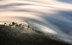 SEA OF CLOUDS   Your Shot photographer Mitsuhiko Kamada used a long exposure to photograph these dreamy morning clouds in Tsubetsu, Hokkaido, Japan. Tsubetsu is a small town in the northeast of Japan, home to about 5,000 people. PHOTOGRAPH BY MITSUHIKO KAMADA, NATIONAL GEOGRAPHIC YOUR SHOT