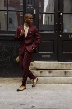 Burgundy suit + tan turtleneck + pocket square + brown dress shoes