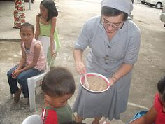 Marian feeding one of the kids. We hope to feed not only their bodies but their spirits as well, as they are feeding ours. Bodies, Spirit, Wellness, Cool Stuff, Kids, Cool Things, Children, Young Children, Child
