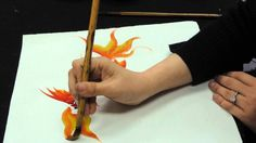 a tutorial on how to make goldfishes in chinese painting style
