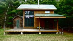 Metal roof, cedar siding, wood stove inside, lots of windows, huge wrap around porch, & sauna near by: perfect!