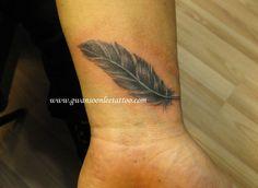 Feather tattoo design on wrist