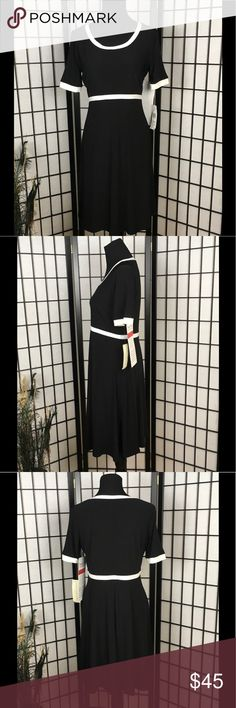 Evan Picone Black &White Dress 10 NWT Brand new fit & flare empire waist black jersey dress with ivory trim. It has short sleeves and is a pull on style. Evan Picone size 10 Evan Picone Dresses