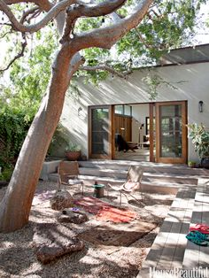 Backyard Wabi-Sabi    Rocks and stones suggest a Japanese garden in this courtyard retreat outside a Los Angeles house designed by Pamela Shamshiri for Commune. Amphitheater-style steps provide extra seating when the homeowners are having a party. Exterior sconces by Robert Lewis for Commune.