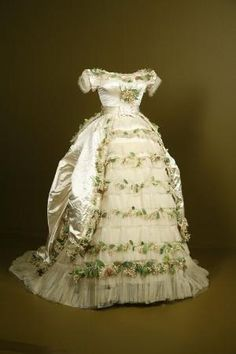 1869 wedding gown of Elisabeth of Wied Queen Consort of Romania in The dress is made of silk satin silk tulle with cotton and paper faux flowers.