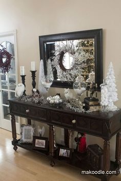 """Christmas Decor for entryway table ~ large candlesticks, flocked white trees, glass jars filled with """"snow"""""""