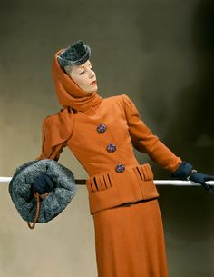 love this 1940's orange suit...love the buttons...love the muff...