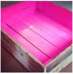 upcycled neon pink painted wooden crate...how cute would this be on the lower shelf of a glass-topped coffee table in the living room?