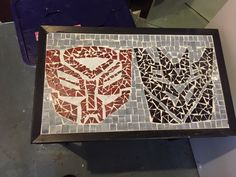 I used stained glass to make this mosaic Transformer table top.